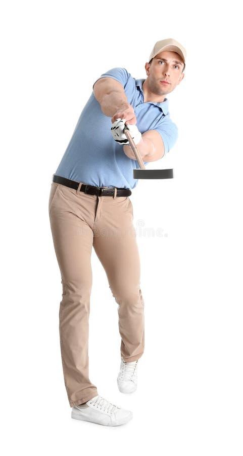 打在白色的年轻人高尔夫球 库存照片