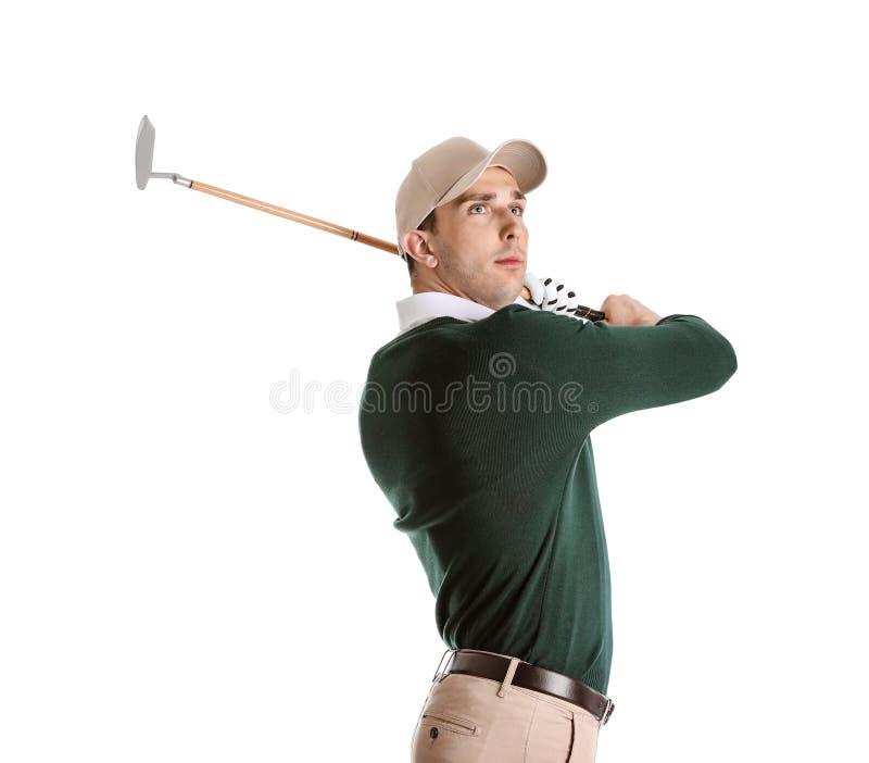 打在白色的年轻人高尔夫球 库存图片