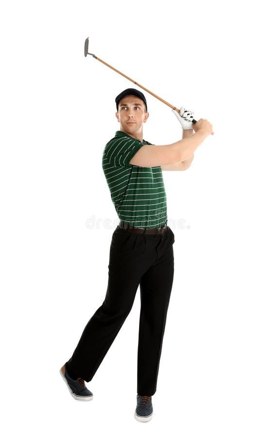 打在白色的年轻人高尔夫球 免版税库存图片