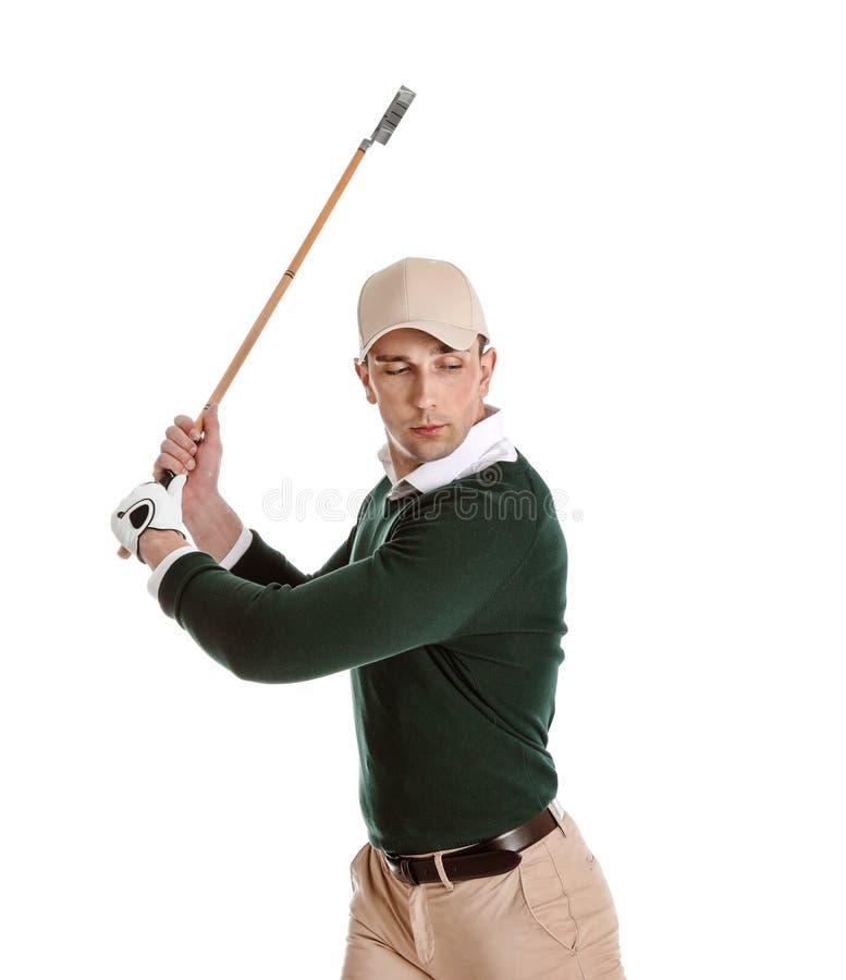 打在白色的年轻人高尔夫球 图库摄影
