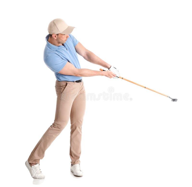 打在白色的年轻人高尔夫球 免版税库存照片