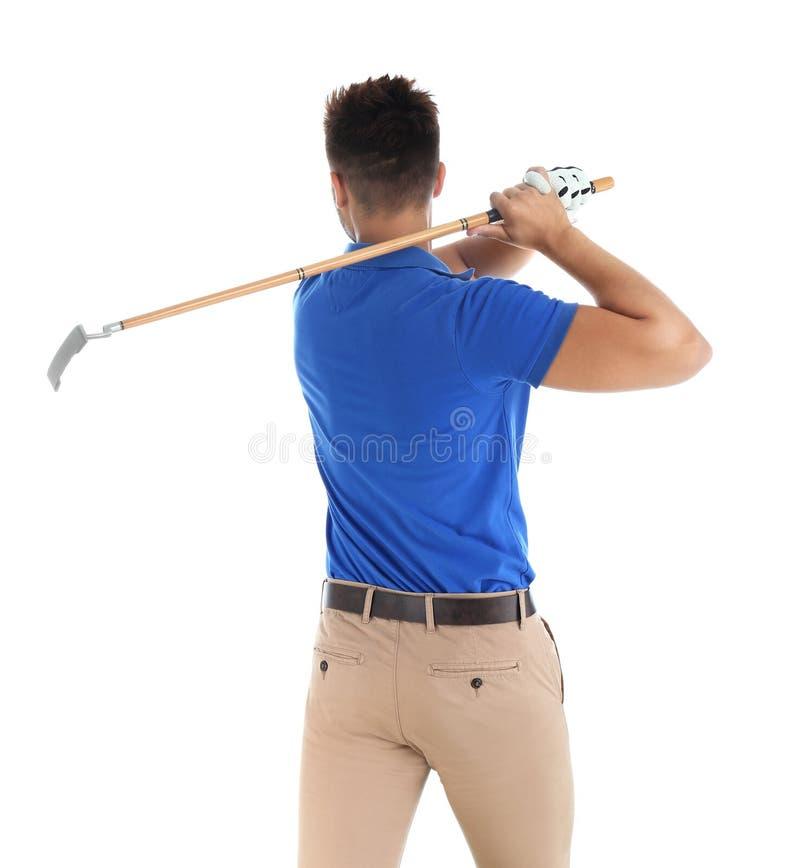 打在白色的年轻人高尔夫球 免版税图库摄影