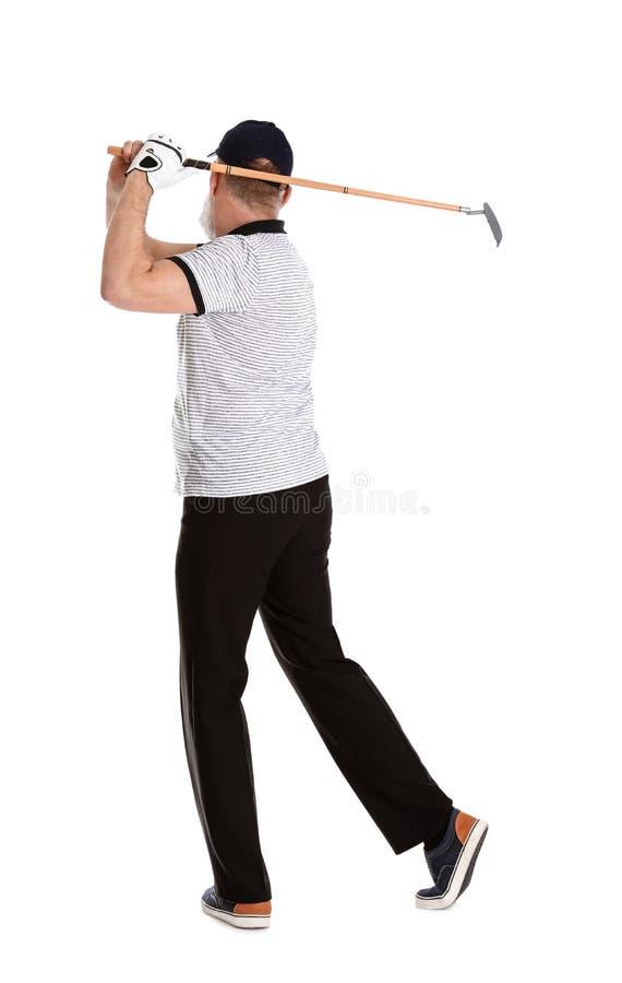 打在白色的老人高尔夫球 图库摄影