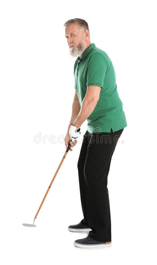 打在白色的老人高尔夫球 免版税库存照片