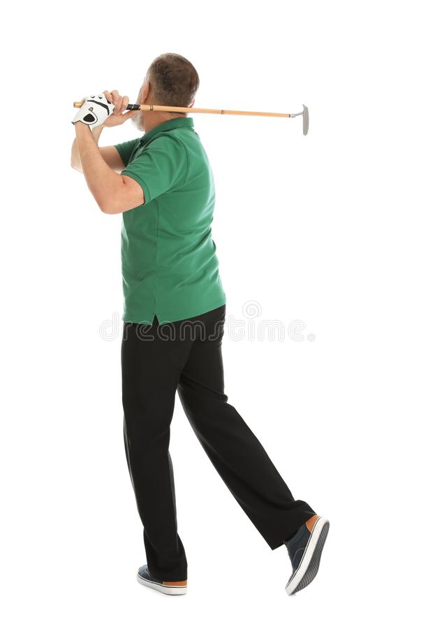 打在白色的老人高尔夫球 免版税图库摄影