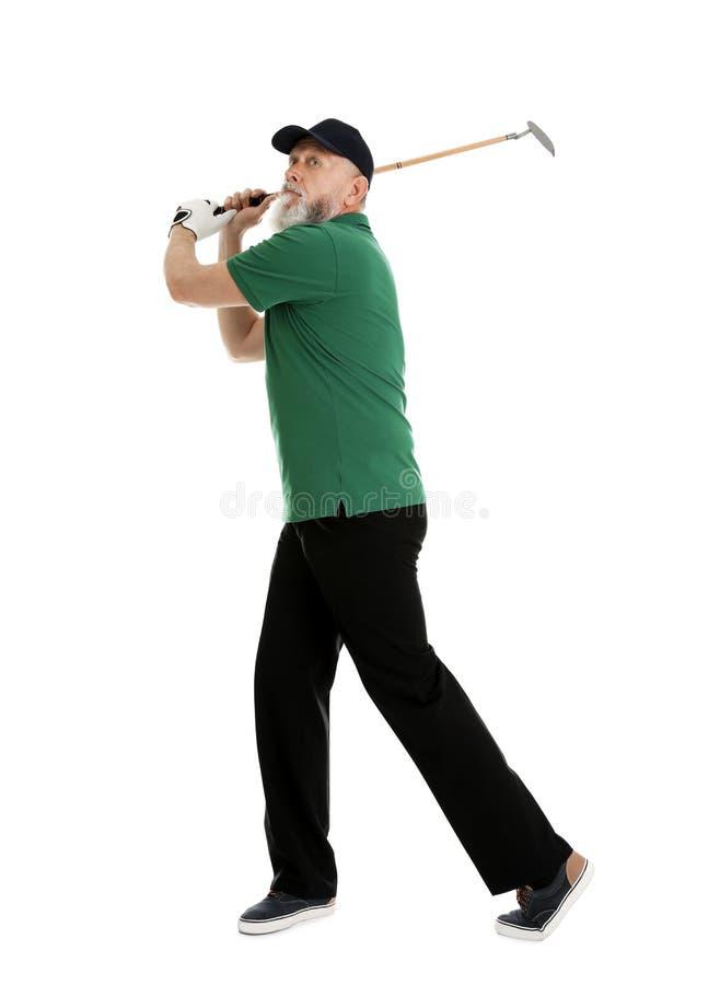 打在白色的老人高尔夫球 库存照片