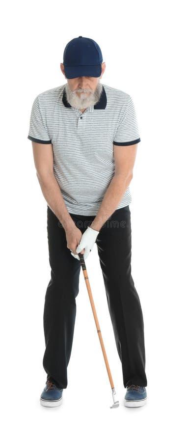 打在白色的老人高尔夫球 免版税库存图片