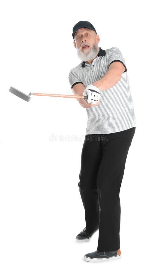 打在白色的老人高尔夫球 库存图片
