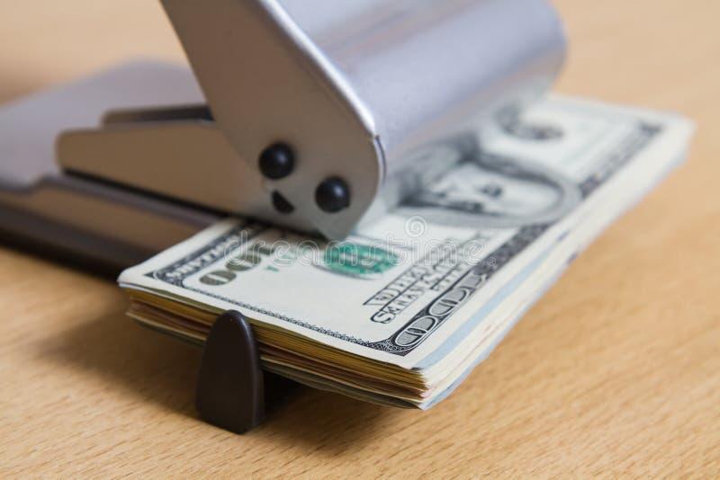 打孔器的纸币特写镜头 企业概念,独特的图象 免版税库存图片