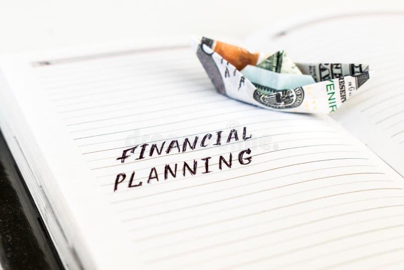 打开与手写文本财政规划和Th的笔记薄 库存图片
