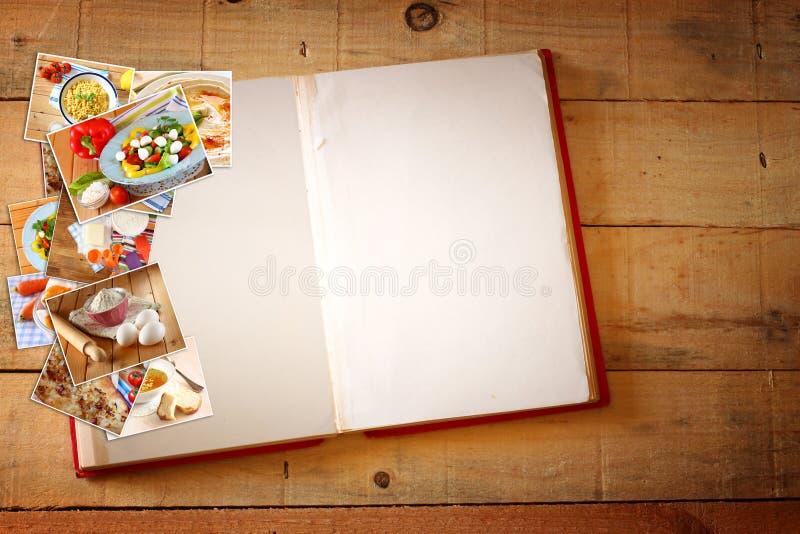 打开与照片空白页和拼贴画的食谱书与各种各样的食物盘的 图库摄影