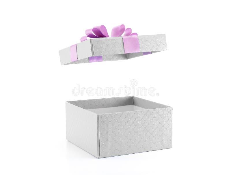打开有紫色丝带的礼物盒 库存照片