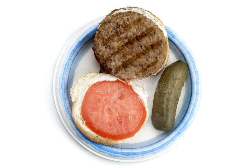打开汉堡用腌汁 库存照片