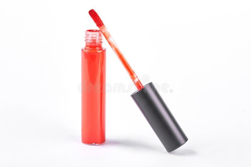 打开红色液体奶油色唇膏 免版税库存图片