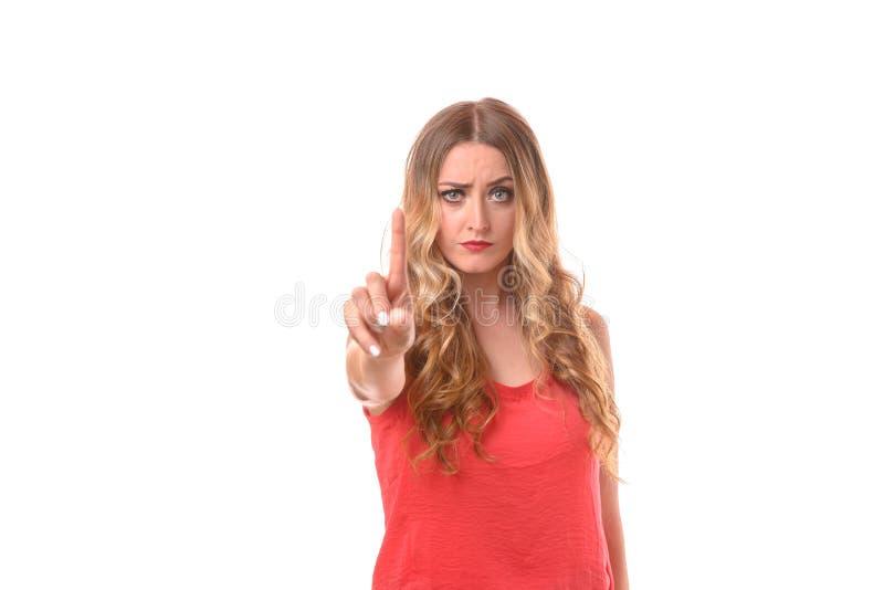 打手势严厉的少妇反对和 免版税库存照片