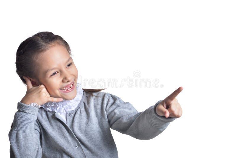 打手势在白色背景的逗人喜爱的女孩画象 免版税库存图片