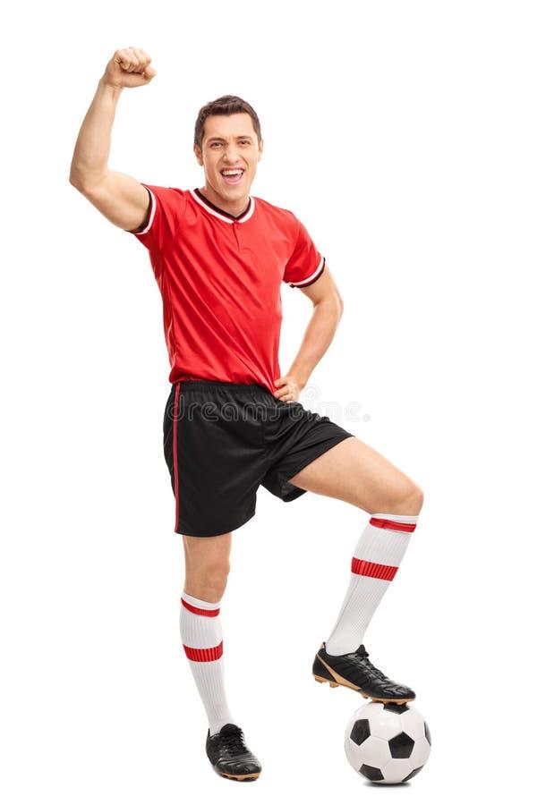 打手势幸福的快乐的足球运动员 库存图片