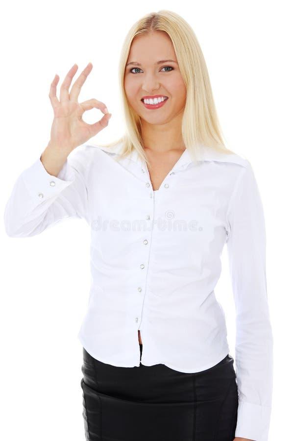打手势愉快的理想的年轻人的女实业&# 免版税库存图片