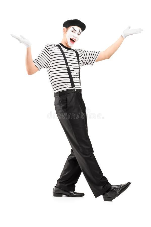 打手势用手的一位男性笑剧舞蹈家的全长画象 库存图片