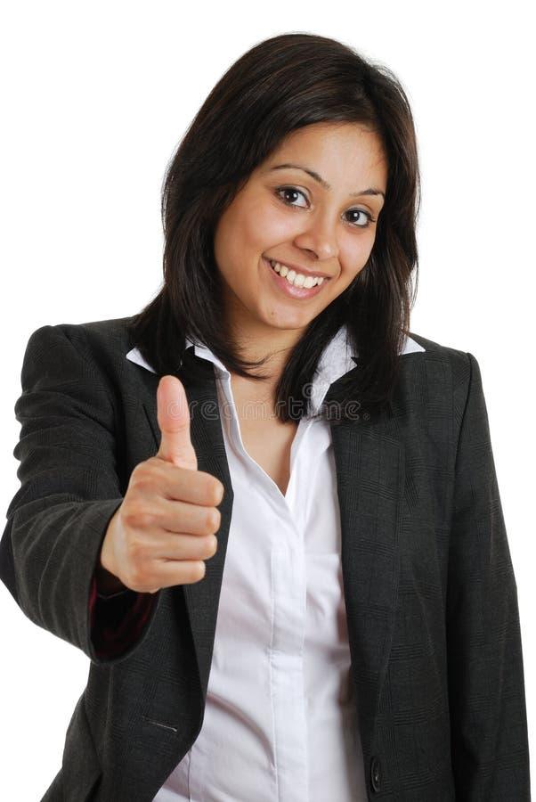打手势赞许妇女的商业 库存照片