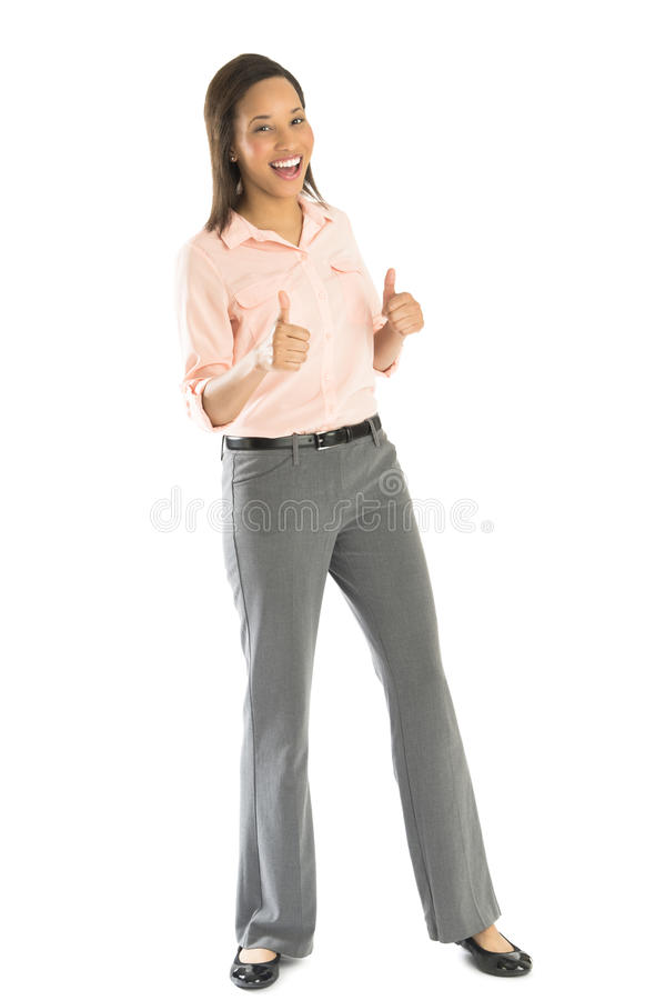 打手势赞许的愉快的女实业家 免版税库存照片