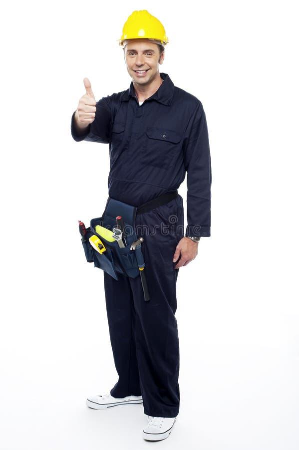 打手势赞许的行业承包商 库存图片