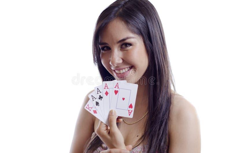打扑克的少妇 免版税库存图片