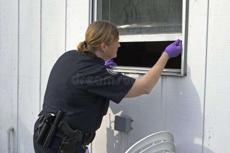 打扫灰尘官员警察打印 免版税库存照片