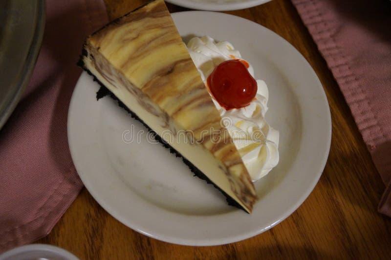 打旋的乳酪蛋糕 免版税库存图片
