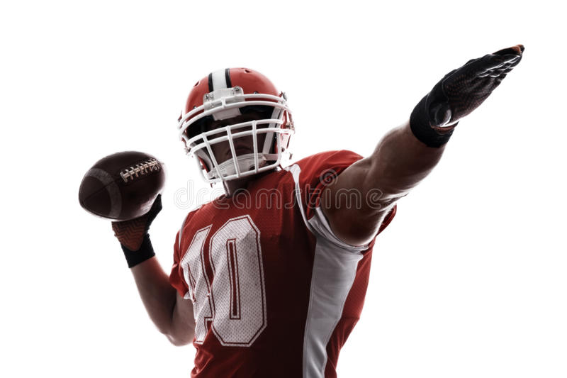 打橄榄球的运动员 免版税图库摄影