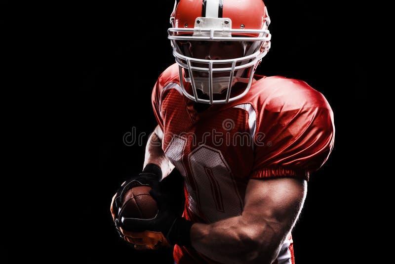 打橄榄球的运动员 库存图片
