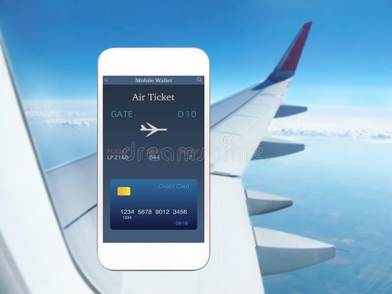 打电话与app流动钱包和飞机票飞机翼 库存图片