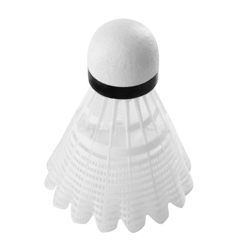 打的羽毛球白色塑料shuttlecock,在白色背景 免版税图库摄影
