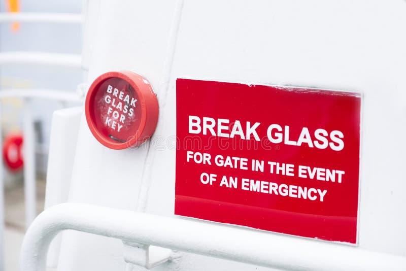 打破玻璃紧急红色标志容器白色背景 库存图片