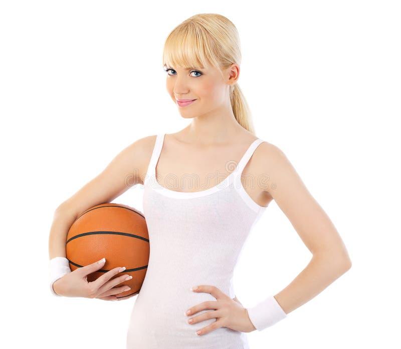打篮球的美丽的妇女 库存图片