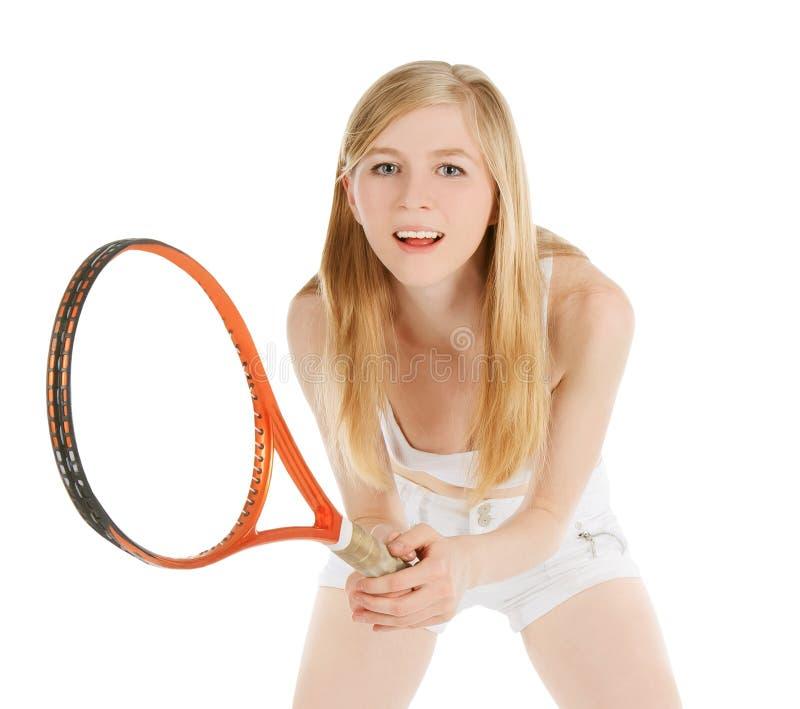 打网球等待的网球的妇女 免版税库存图片