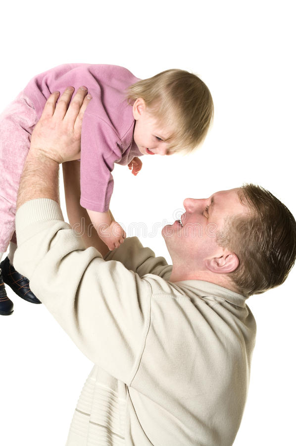 扔儿童的父亲  免版税库存图片