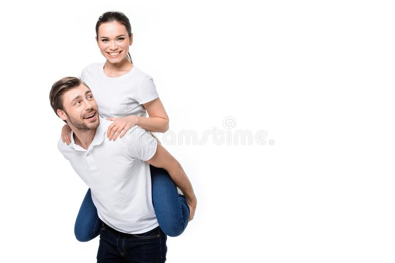 扛在肩上的夫妇 免版税库存图片