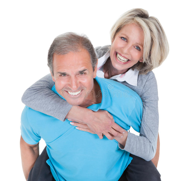 扛在肩上他的妻子的成熟人 库存照片