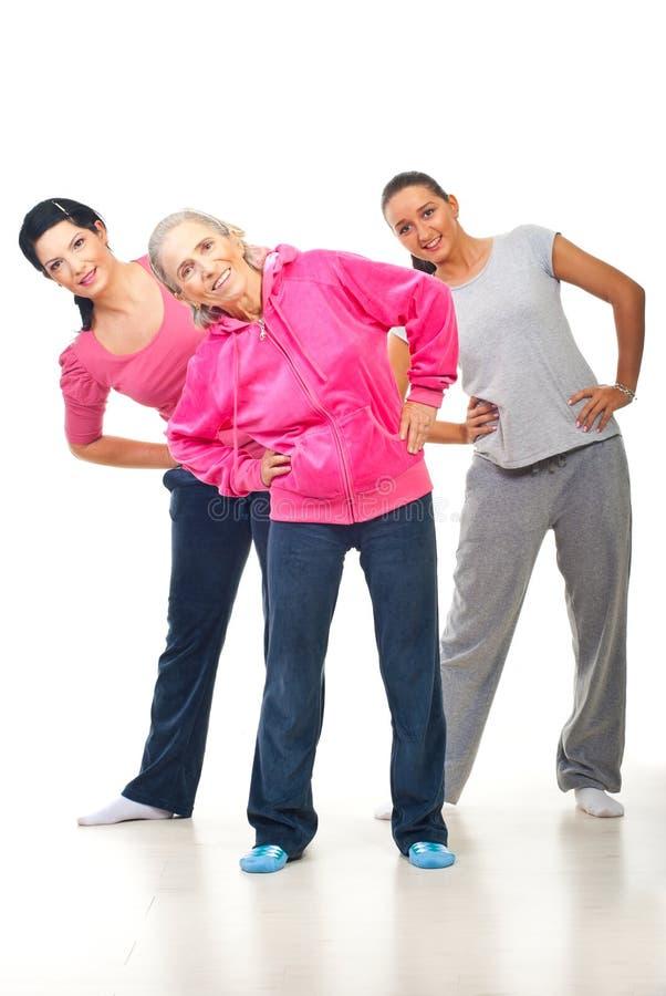 执行体育运动的三名妇女 库存照片