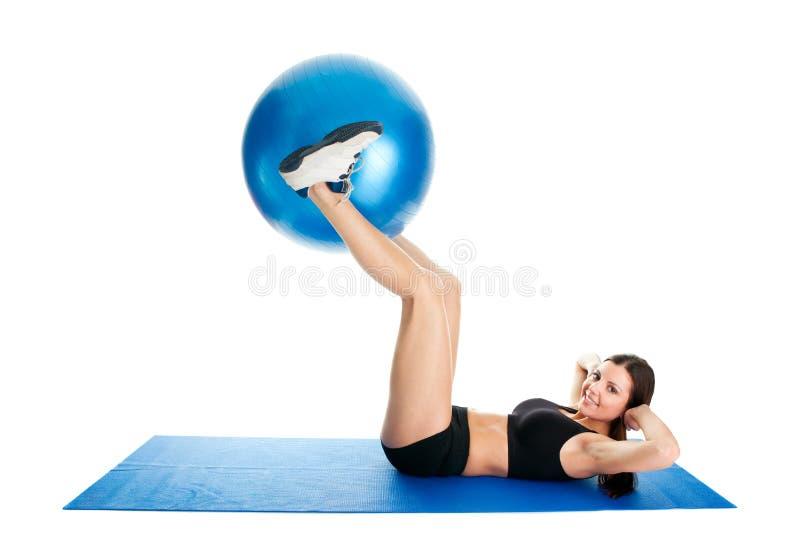 执行健身体操席子妇女的咬嚼 库存照片