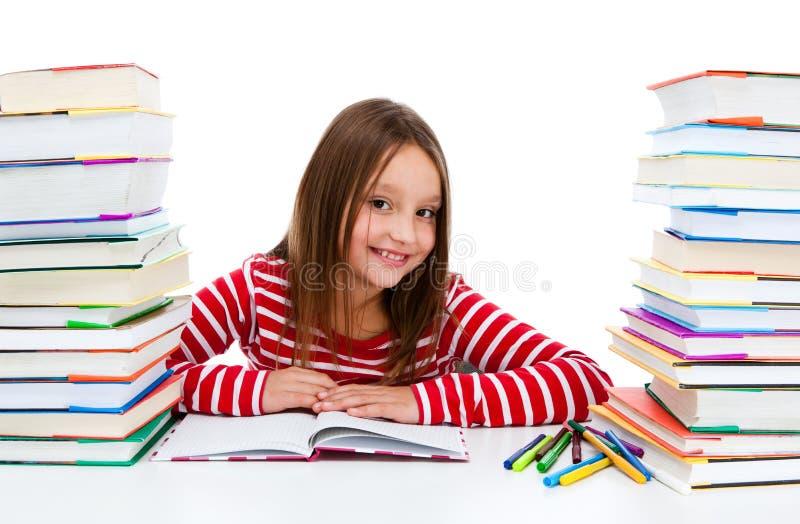 执行女孩家庭作业查出的白色的背景 图库摄影