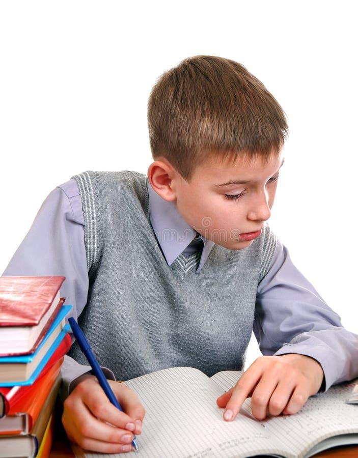 执行家庭作业孩子 免版税图库摄影