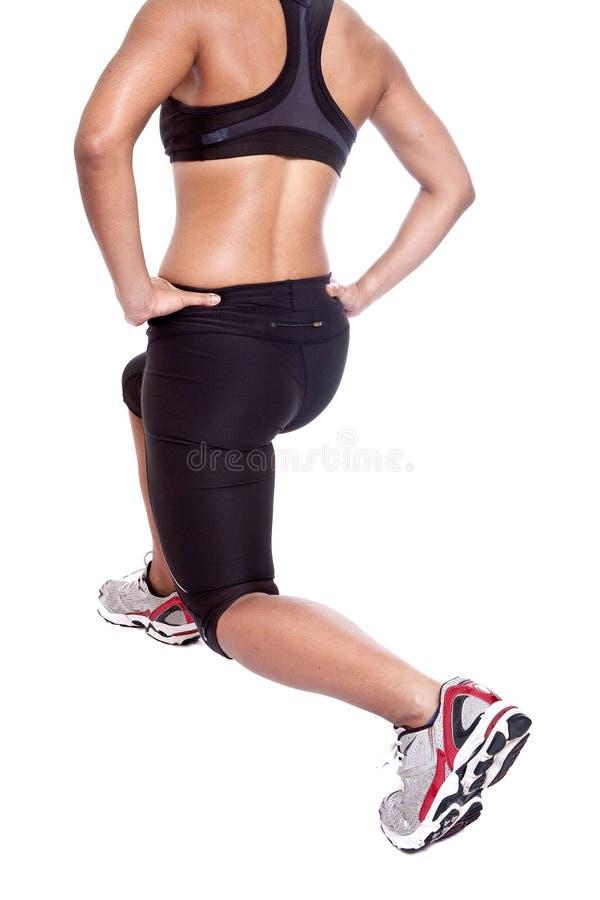 执行执行女性的运动员她舒展 免版税库存图片