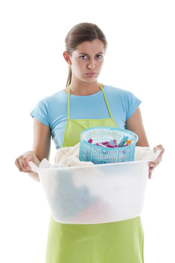 执行洗衣店疲乏的妇女 免版税库存图片