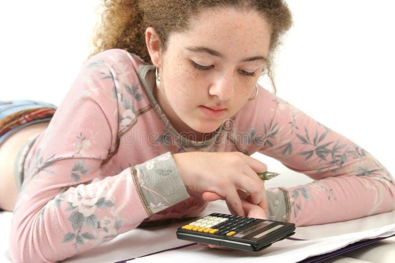 执行青少年的家庭作业 免版税图库摄影
