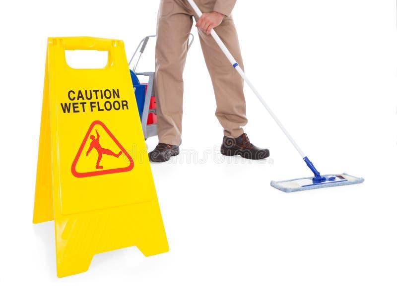 扫除机与警报信号的清洁地板 免版税库存照片