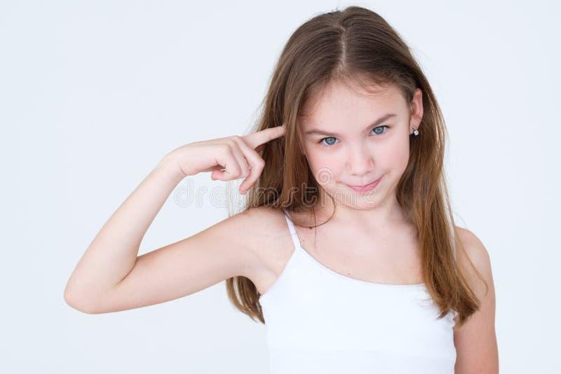 扭转手指寺庙的情感不许可的孩子 免版税库存照片