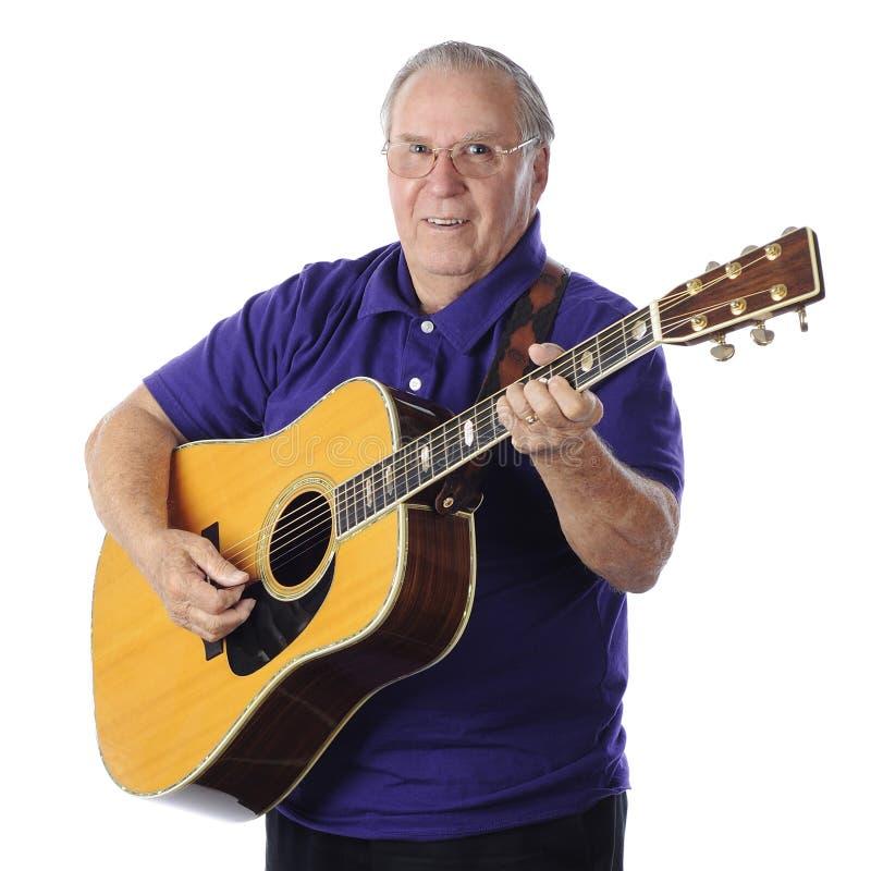 扮演吉他的前辈 免版税库存图片