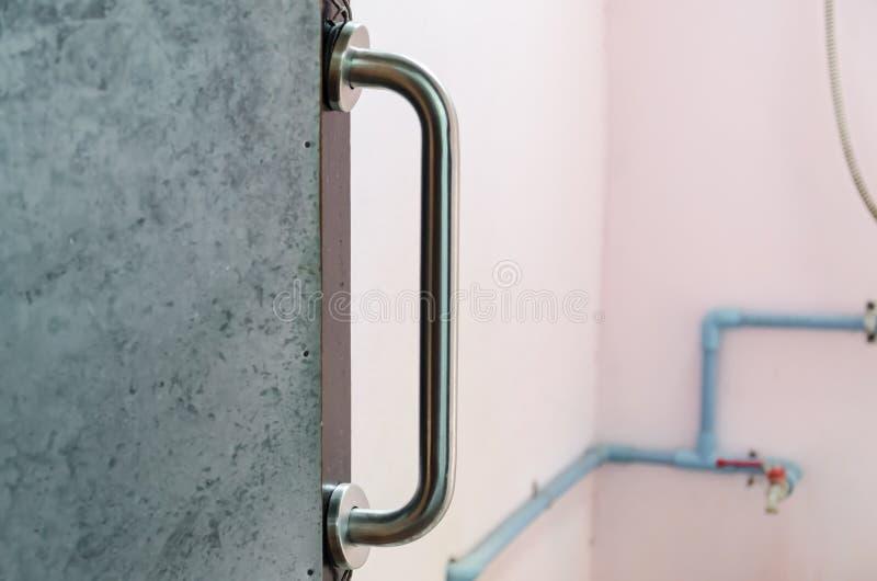 扶手栏杆被设定对卫生间门 图库摄影